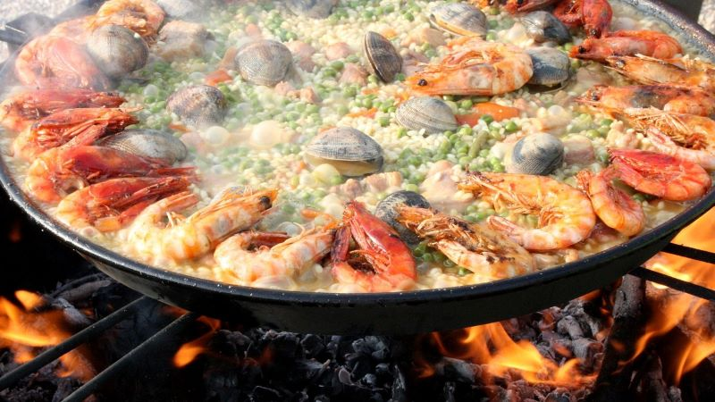 Paella Cooking Over Wood Fire